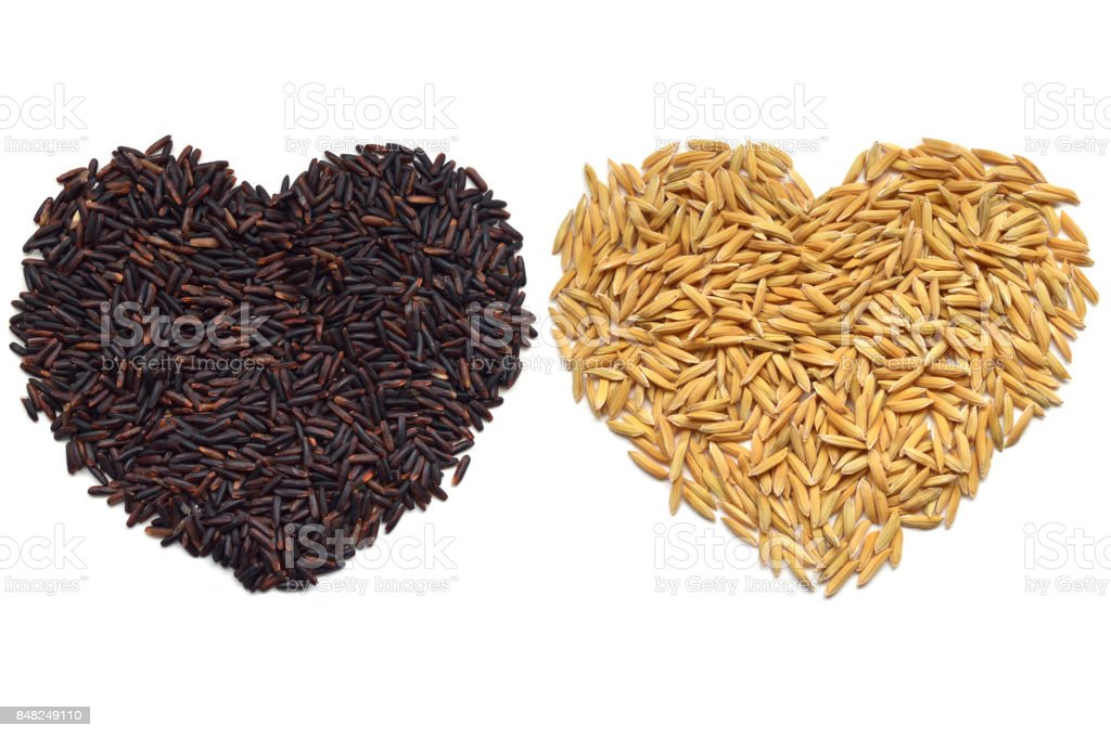 Riceberry and paddy rice heart shape stock photo