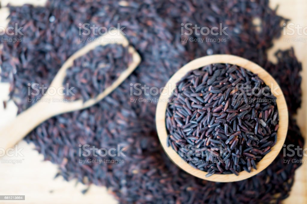 Riceberry in a wooden bowl on wooden background stock photo