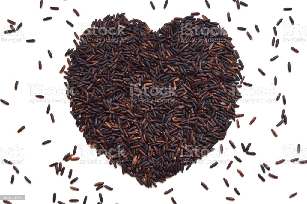 Riceberry seed heart shape stock photo