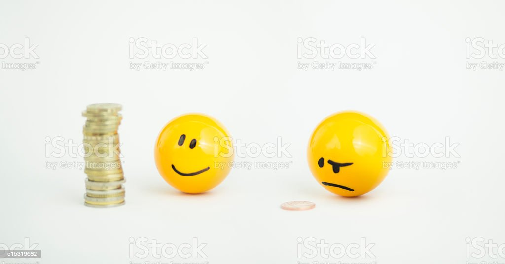 rich and poor emoji stock photo