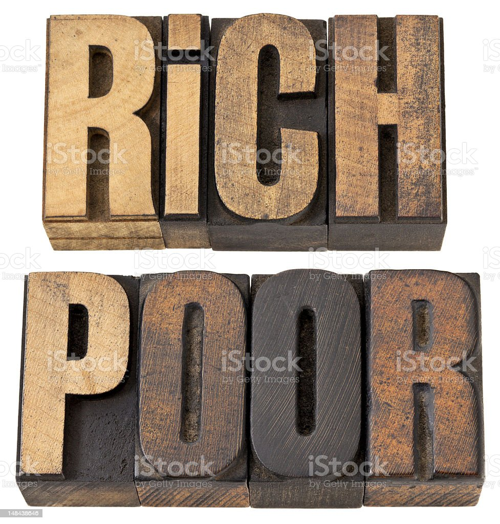 rich and poor words stock photo