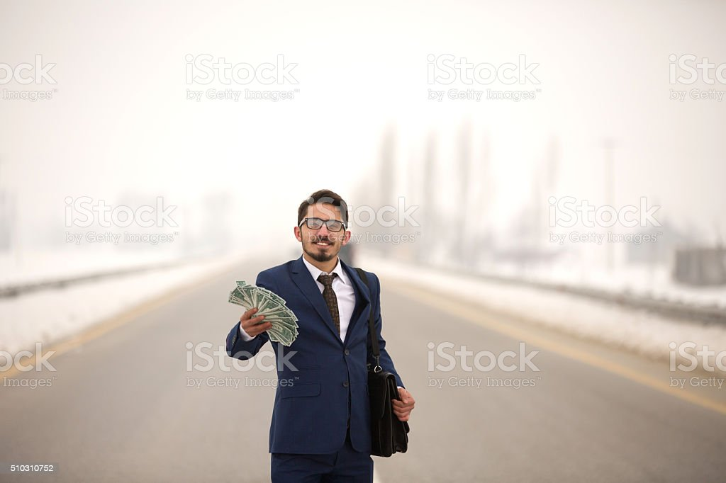 rich businessman get dollar money from a gain stock photo