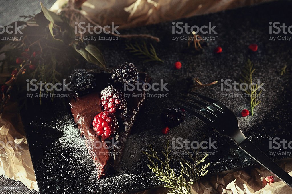 Rich Chocolate Layer Cake with Berries stock photo