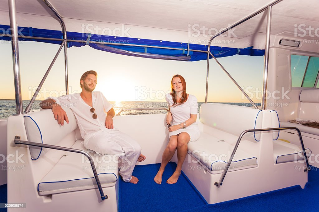 rich couple private motor yacht stock photo