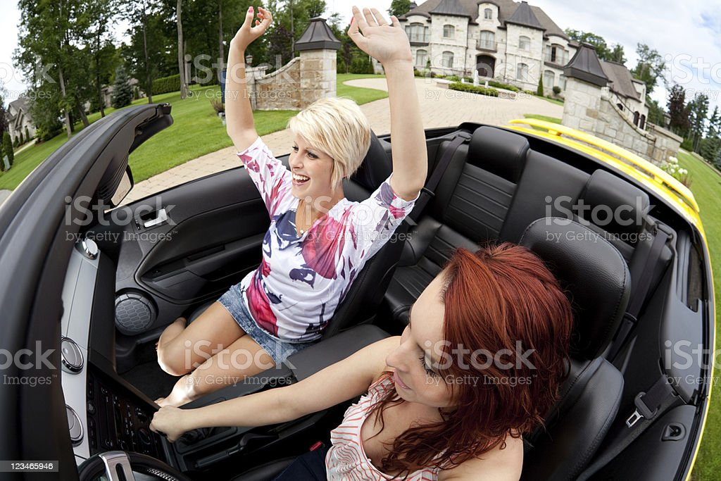 Rich friends going for a drive stock photo