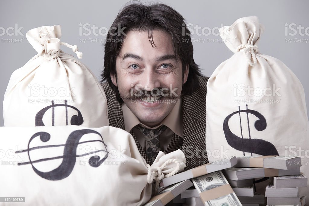 Rich man counting down money royalty-free stock photo