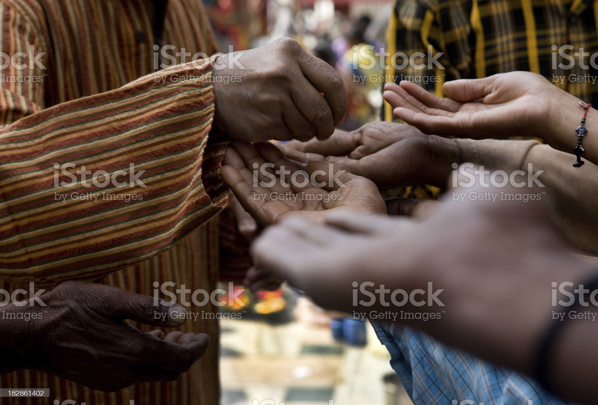 Rich man helping begging poor people royalty-free stock photo