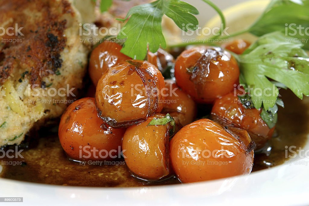 Rich Roasted tomatoes and fishcakes dish royalty-free stock photo