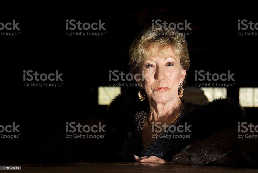 Rich senior woman in furs stock photo