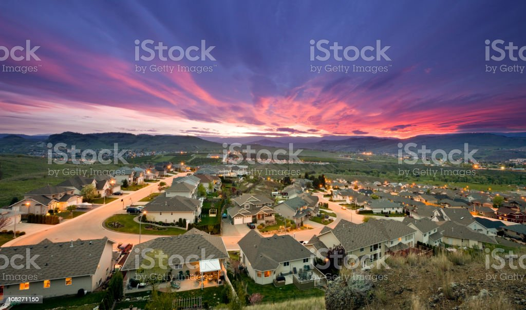 Rich suburb street and family homes urban sprawl stock photo