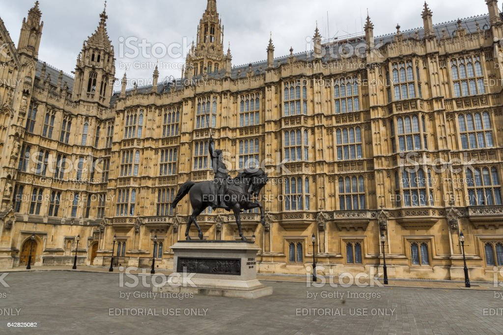 LONDON, ENGLAND - JUNE 19 2016: Richard I monument in front of Houses of Parliament, London, England stock photo