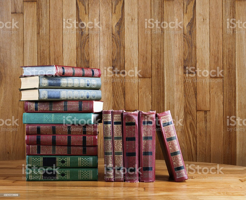 Richly decorated volumes of books with a gold lettering stock photo