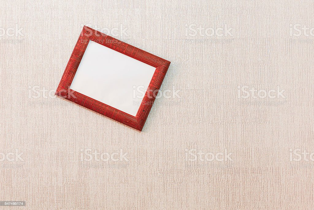 Rickety empty picture frame on the wall stock photo