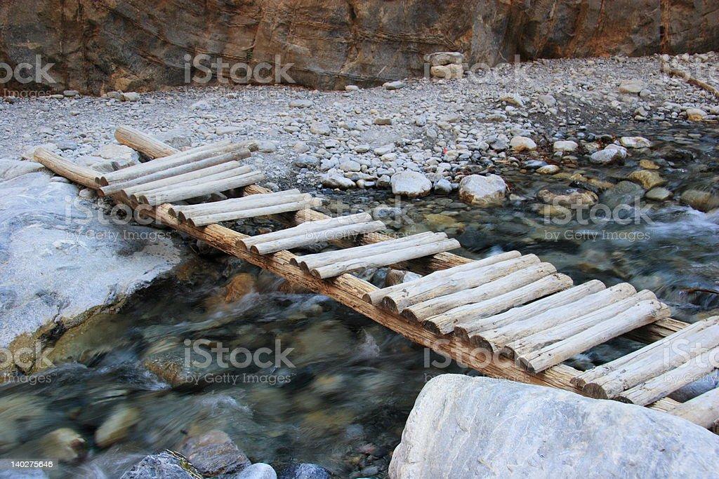 Rickety Old Bridge over stream royalty-free stock photo