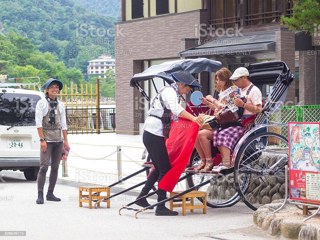Ricksha ride at the street on Miyajima stock photo