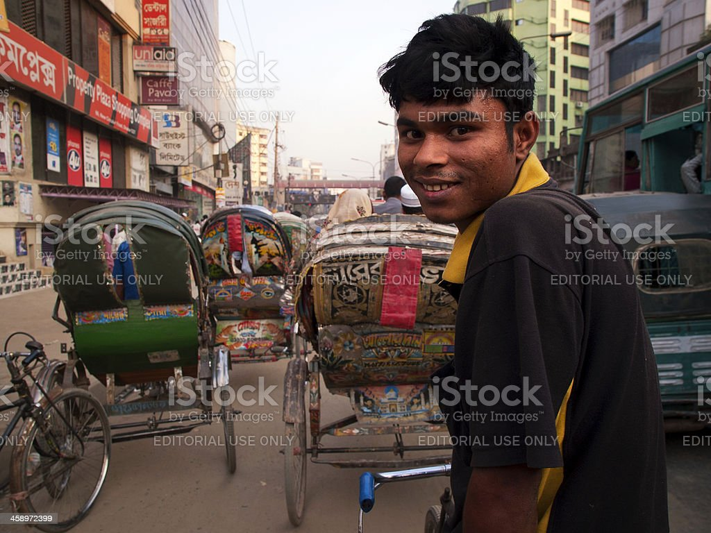 Rickshaw driver patiently wait on the vehicle during traffic jam stock photo