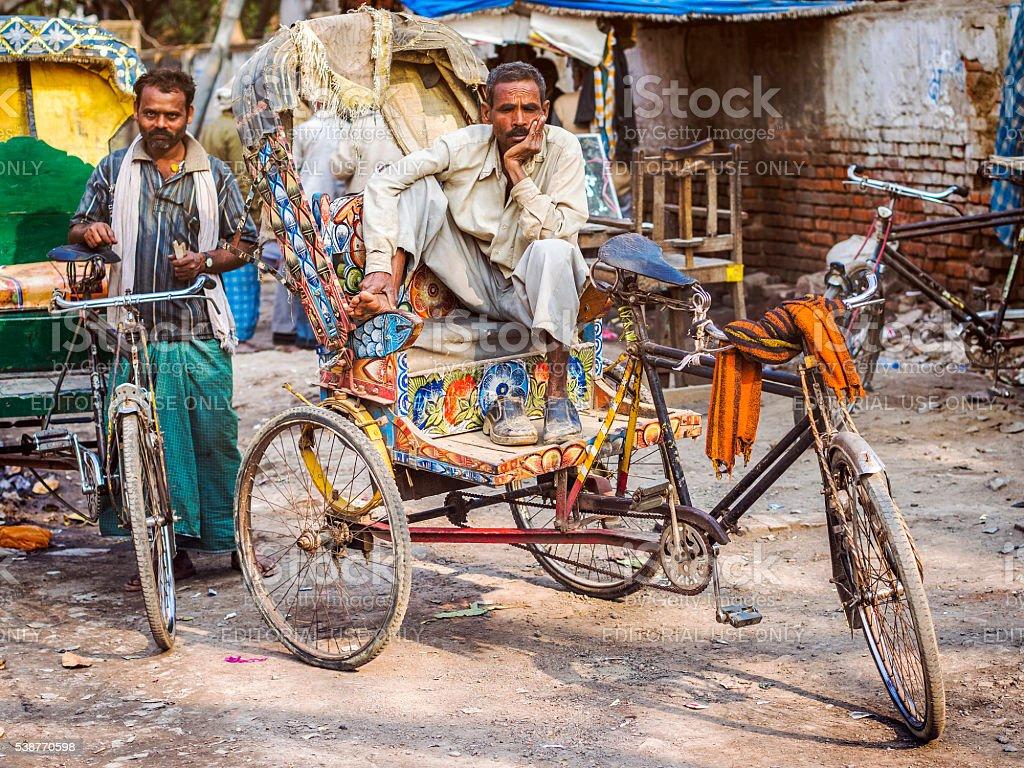 Rickshaw Drivers on the Streets of New Delhi, India stock photo