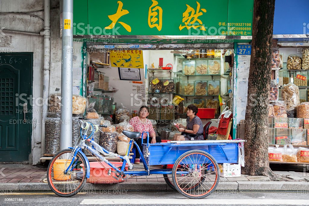 Rickshaw in front of small shop in Guangzhou, Сhina stock photo
