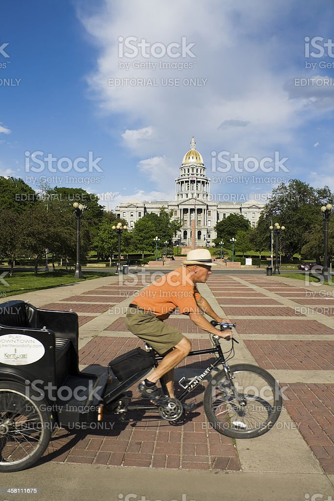 Rickshaw man in front of State Capitol Building royalty-free stock photo