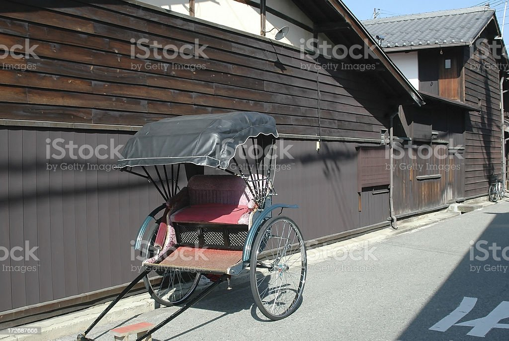 Rickshaw on sidestreet in historic district of old houses royalty-free stock photo