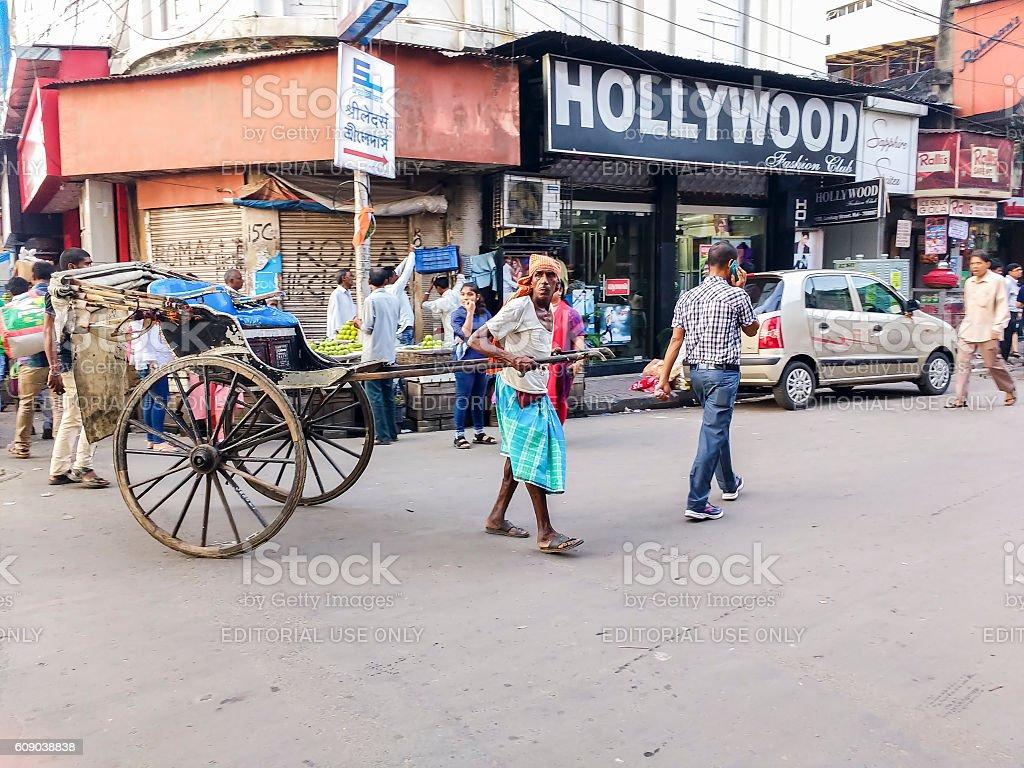 Rickshaw puller on Kolkata street, India stock photo