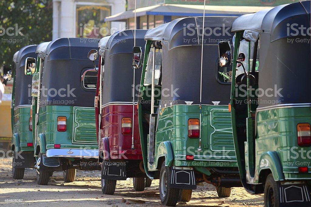 Rickshaws lined up stock photo