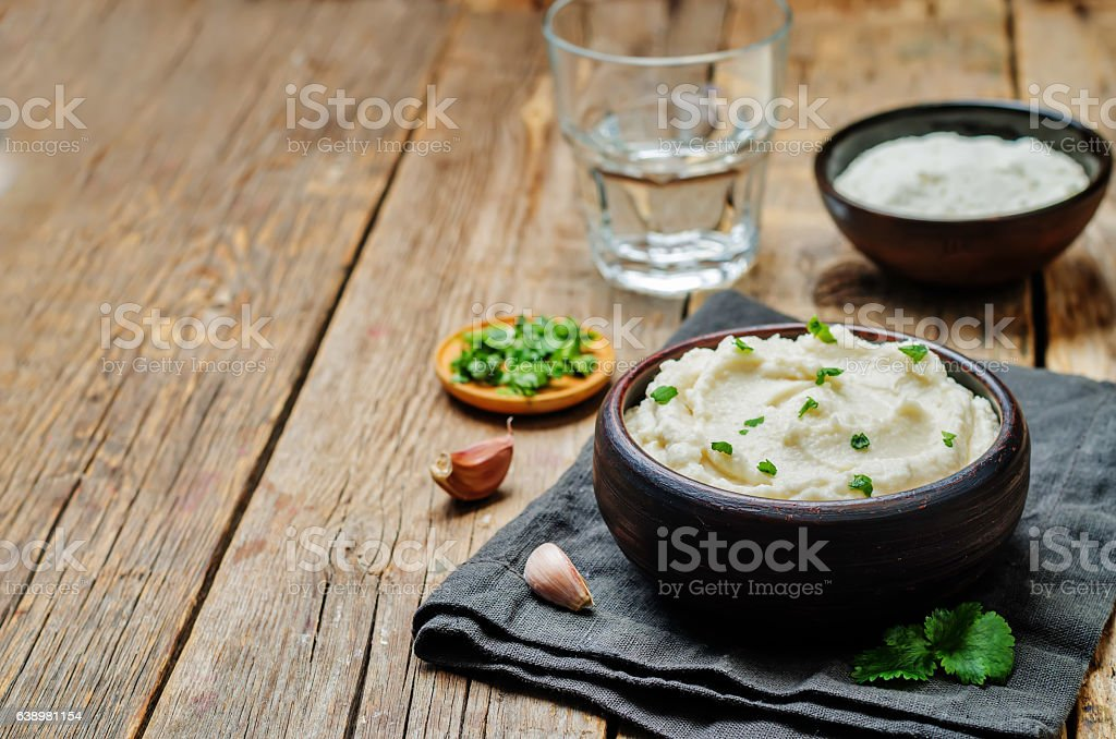 Ricotta roasted garlic mashed cauliflower stock photo