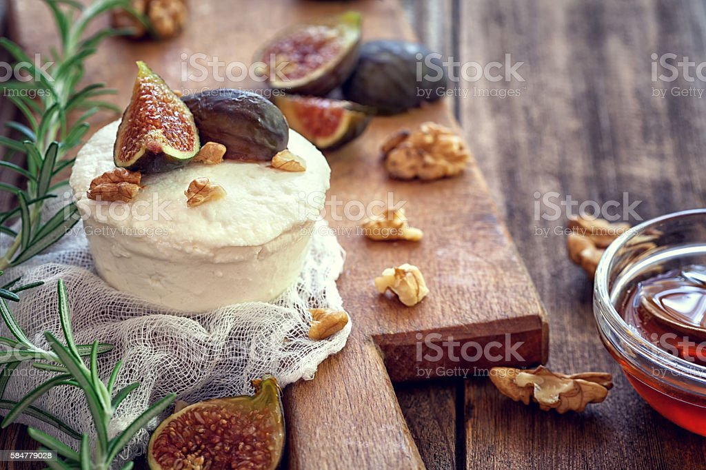 Ricotta with ripe sliced fig fruits, nuts and honey stock photo