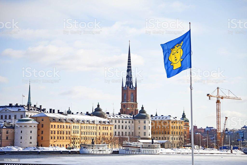 Riddarholmen, winter. Stockholm city flag St. Erik  in the foreground. stock photo