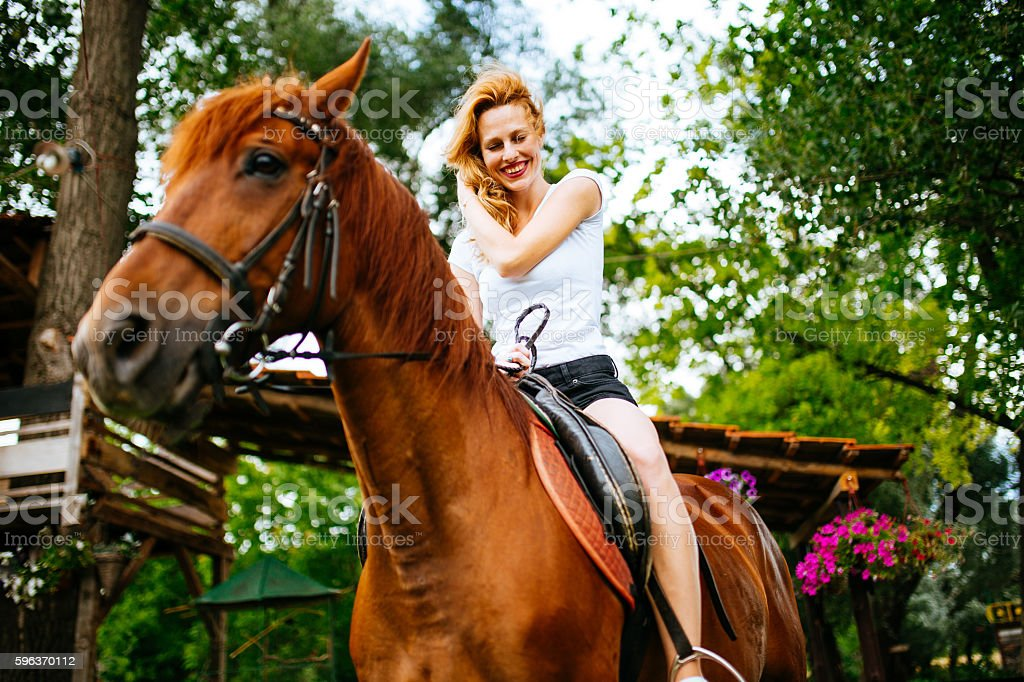 Ridding a horse is fun stock photo