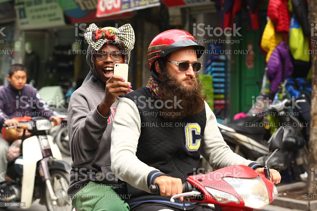 Ride and take a photo. stock photo