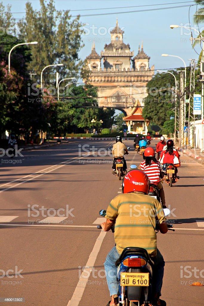 Ride at Sunrise - Vientiane, Laos. stock photo