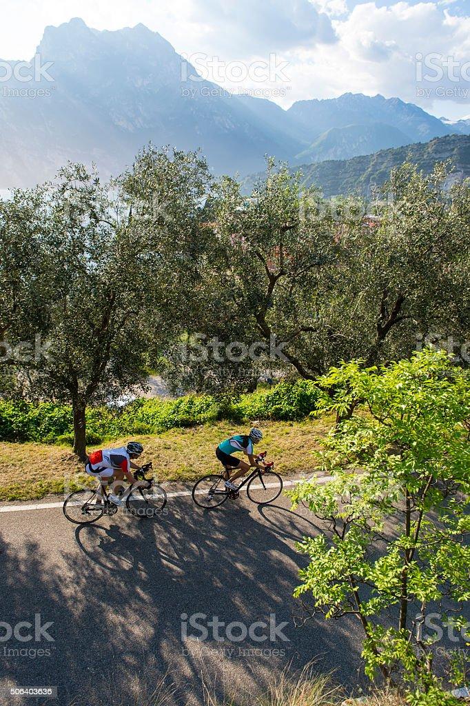 ride togheter - road cycling - garda lake stock photo