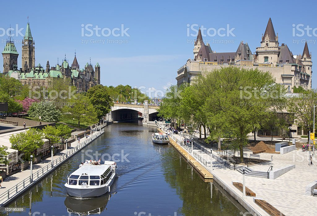 Rideau Canal, boat cruise and Parliament of Canada stock photo