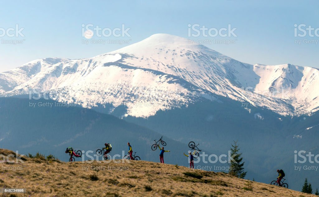 rider among  fantastic snow peaks stock photo