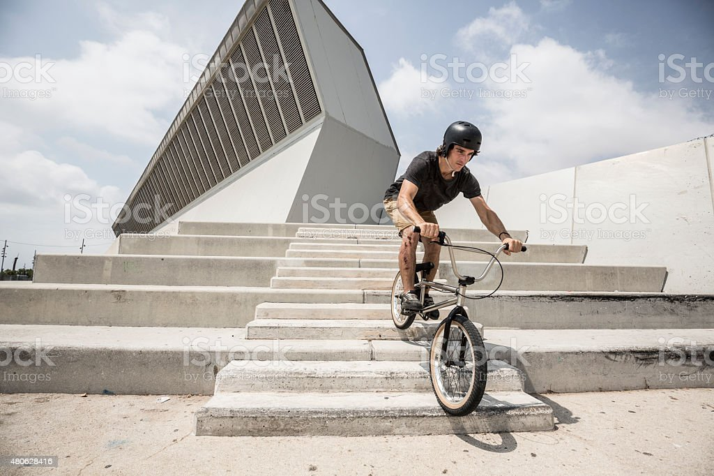 Bmx rider going down stairs