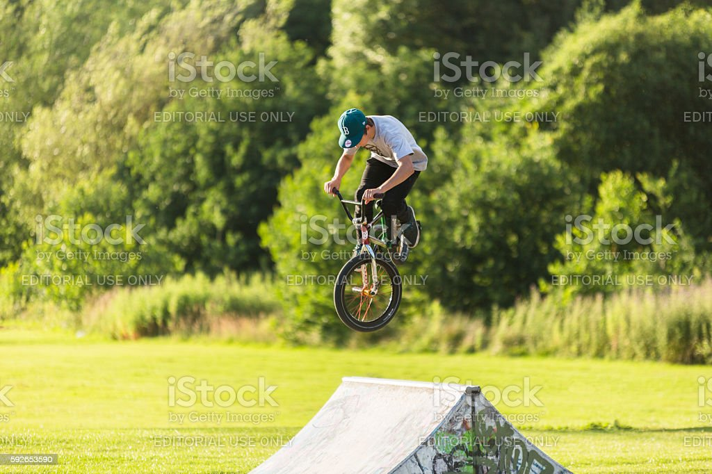 BMX rider jumping obstacle in Skate Park stock photo