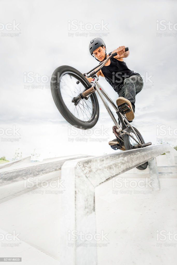 BMX rider in performing tricks.