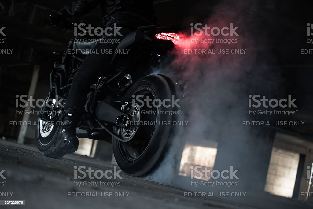 rider ride and burn wheel tire stock photo
