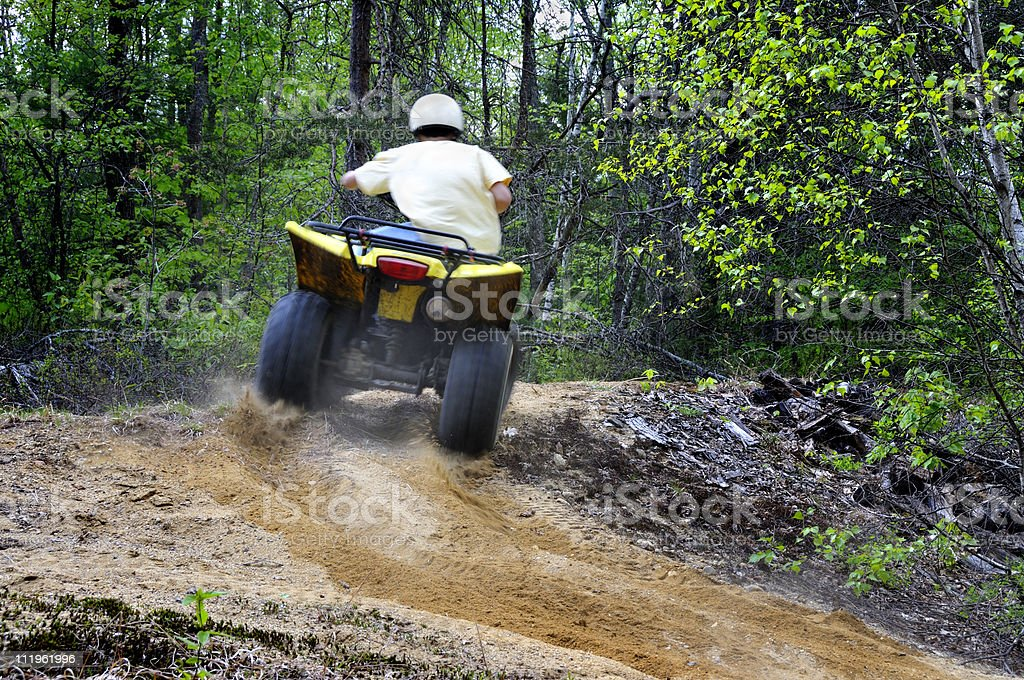 ATV Rider Takes on the Trail royalty-free stock photo