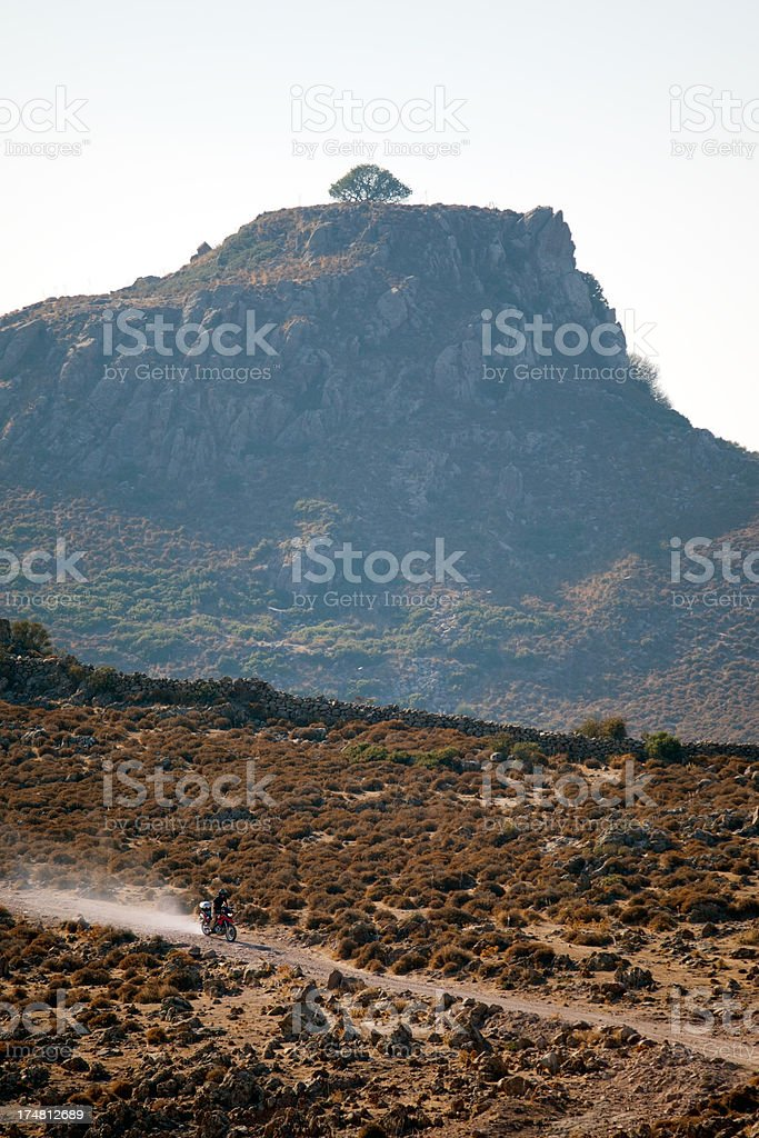 Rider with red motorcycle on off-road stock photo