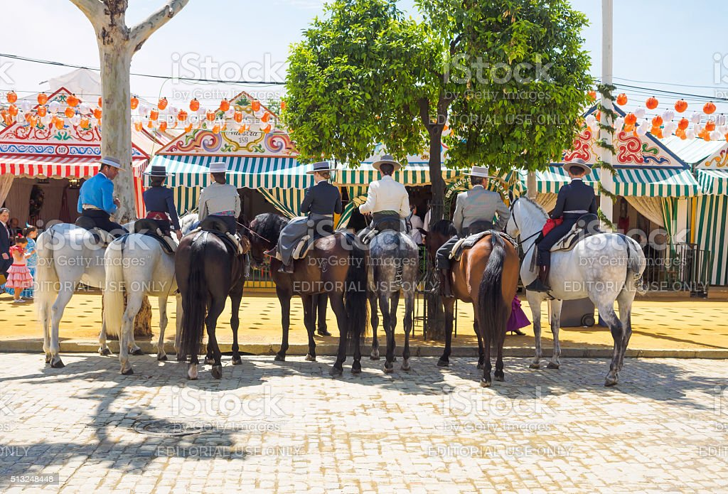 Riders in traditional dress at the April Fair of Seville stock photo