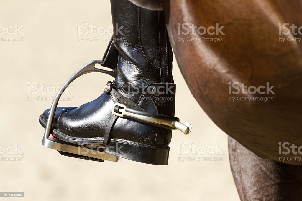 Rider's leg stock photo