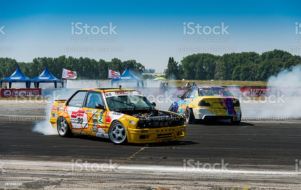 Riders on the cars brand BMW makes a mistake on the track in the...