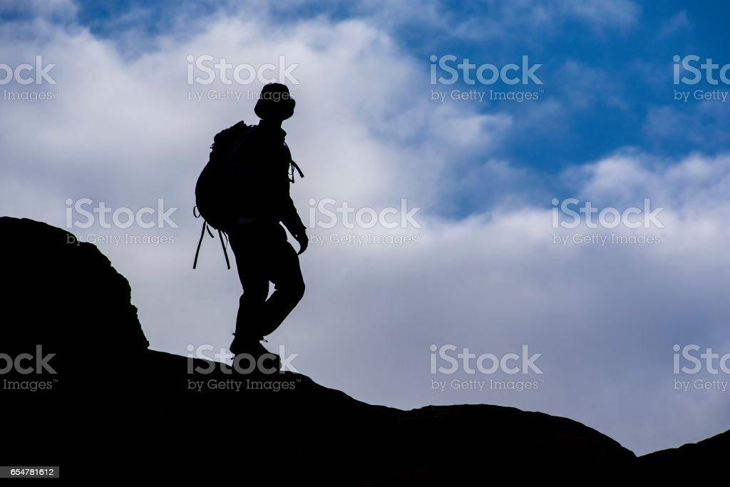 Ridge hiker silhouette stock photo