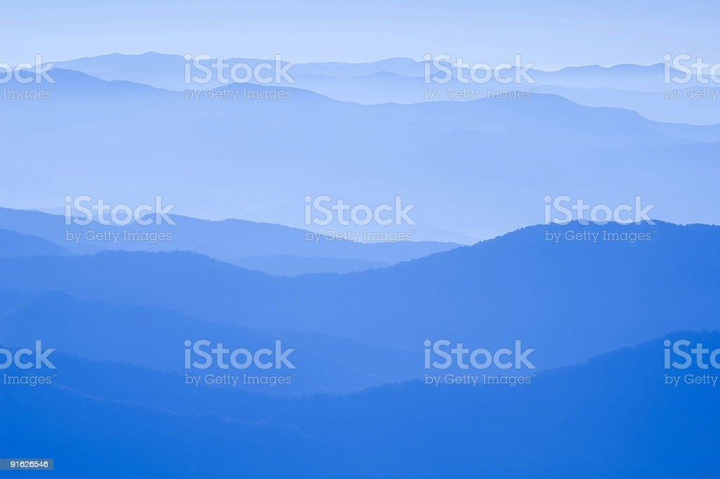 Ridge mountains in different shades of blue stock photo