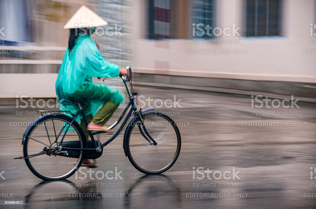 Riding A Bicycle In The Rain In Nha Trang, Vietnam stock photo