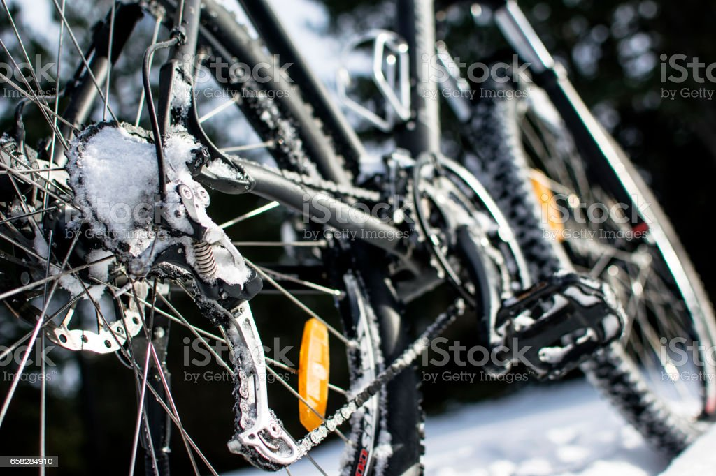 Riding a bicycle in Winter over snow stock photo