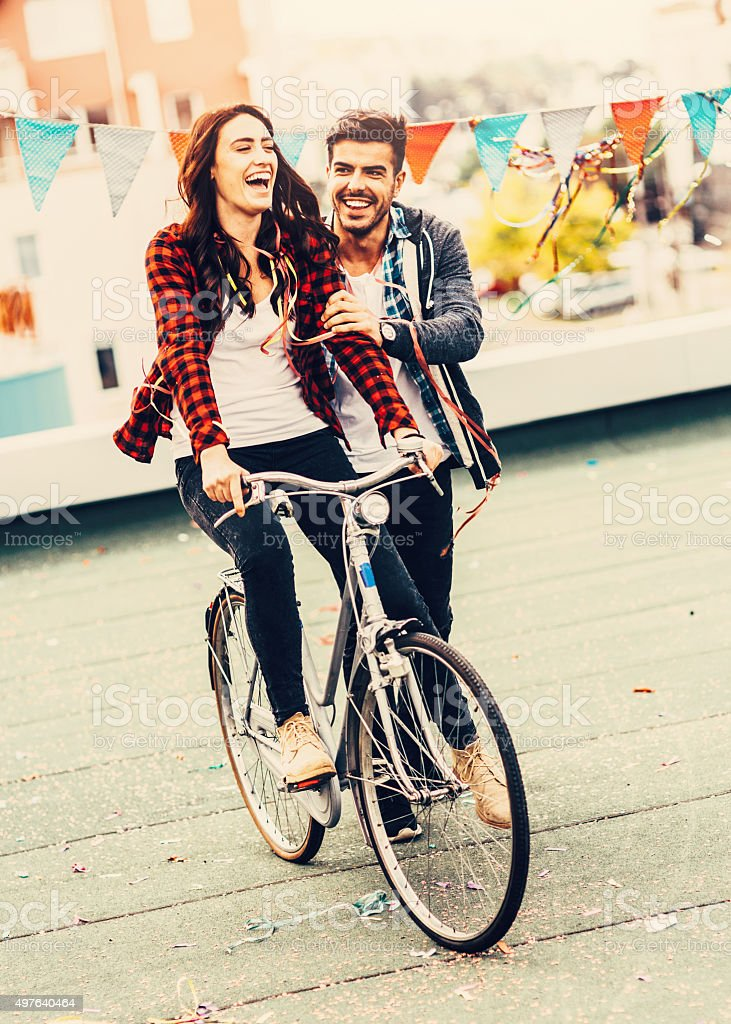 Riding a bicycle on the roof stock photo