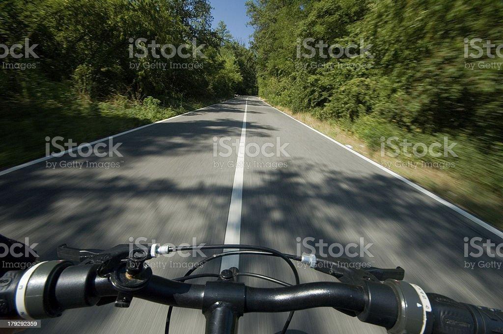 Riding a byke (III) stock photo